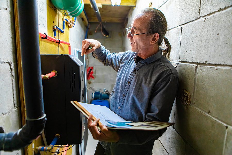 Man writing a house inspection report